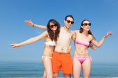 Happy Friends Embraced at Seaside — Stock Photo