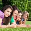 Teenage Female Friends Lying on Green at Park — Stock Photo #5908589