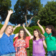 Happy Teenage Girls with Outstretched Arms — Stock Photo #5908764