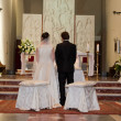 Bride and Groom in front of Altar — Stock Photo