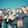 Happy College Students with Thumbs Up — Stock Photo #6031911