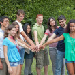 Happy Teenage Group with Hands on Stack — Stock Photo