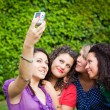 Stock Photo: Female Teenagers Taking Self Portrait