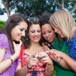 Female Teenagers Looking Photos in the Camera — Stock Photo