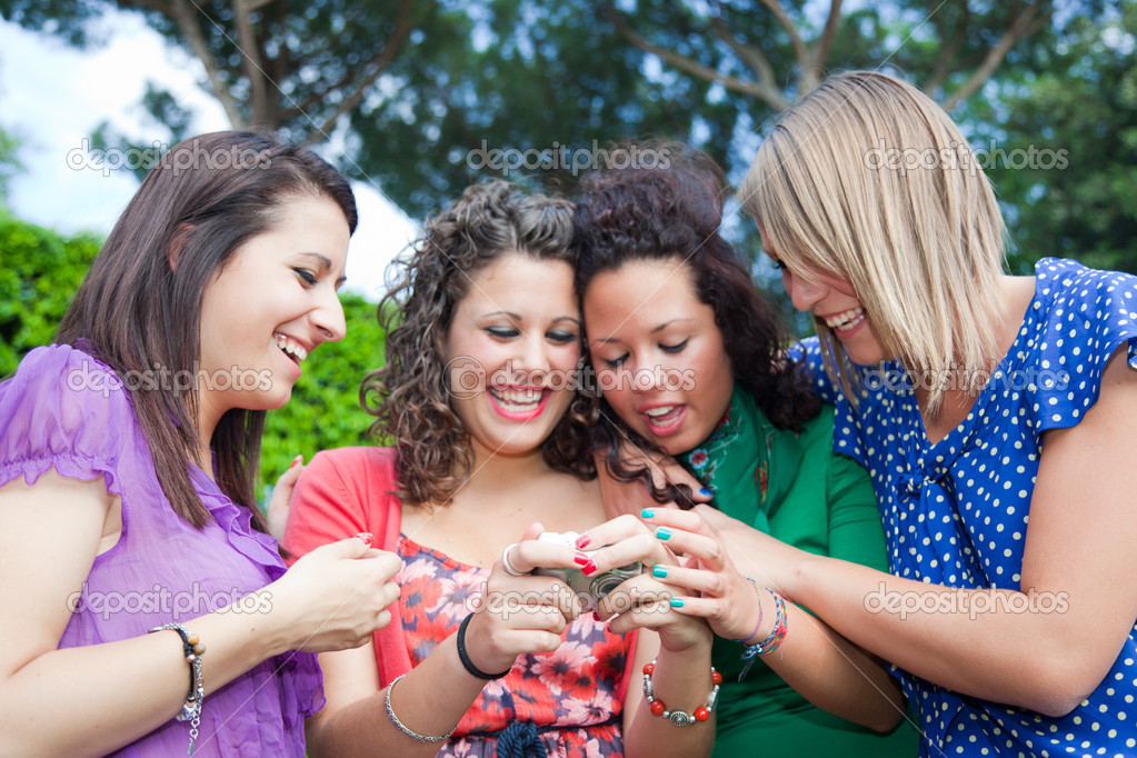 Female Teenagers Looking Photos in the Camera — Stock Photo #6067651