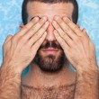 Young Man with Hands on Eyes — Stock Photo #6376604