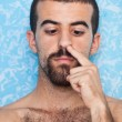 Young Man Picking Up His Nose — Stock Photo #6376645