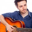 Young Man Playing Guitar — Stock Photo #6410940
