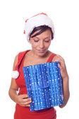 Sexy vrouw met santa hat en kerstmis geschenken — Stockfoto