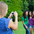 Girl Taking Photos to Her Friends — Stock Photo #6505839