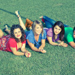 Teenage Female Friends Lying on Green at Park — Photo