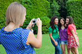Girl Taking Photos to Her Friends — Stock Photo