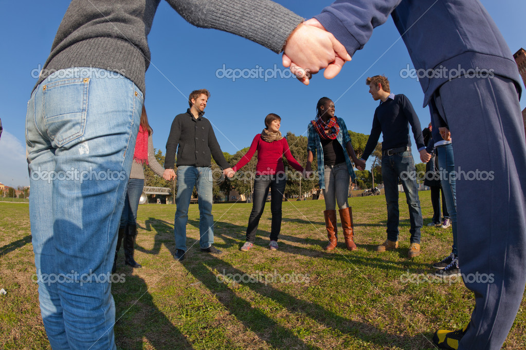 Multiracial Young Holding Hands in a Circle — Stock Photo #6539324