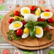 Foto Stock: Boiled Eggs on Cutting Board