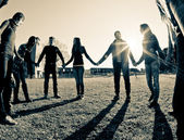 Multiracial Young Holding Hands in a Circle — Stock Photo