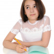 The girl with pencil and writing-book — Stock Photo #6735321