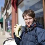 Woman with banana — Stock Photo