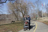 Couple with baby carriage — Stock Photo