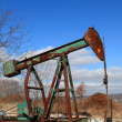 Stock Photo: Rusty pump jack