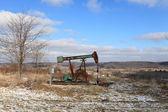 Oil Field pump jack — Stock Photo