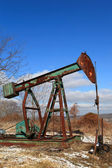 Rusty pump jack — Stock Photo