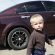 Stock Photo: Little boy and car