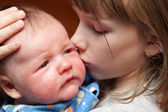 Sister kisses her brother — Stock Photo