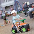 Stock Photo: Child drives toy ATV