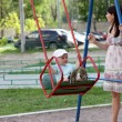 Mother swings her child — Stock Photo