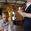 Waiter takes order - Stock Photo