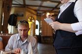 Waiter takes order — Stock Photo