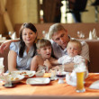 Stock Photo: Family at restaurant