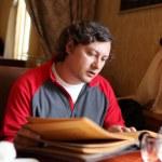 Man reads menu — Stock Photo #5958438