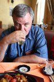 Man drinks tea — Stock Photo