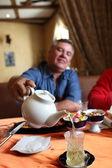 Man pours green tea — Stock Photo