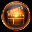 Movie clapper board icon golden, isolated on black background. — Stock Photo