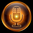 Microphone icon golden, isolated on black background. - Stock Photo