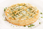 Tasty quiche with cheese and herbs — Stock Photo