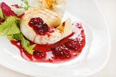 Camembert with cherry sauce — Stock Photo