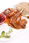 Duck wings with cranberry sauce — Stock Photo