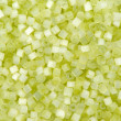Background of green decorative plastic craft beads — Stock Photo