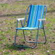 Empty garden chair on grass — Stock Photo