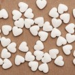White pills in the form of heart — Stock Photo