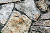 Colorful and textured stone masonry wall useful for backgrounds — Stock Photo