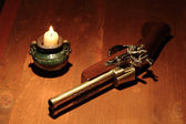 Ancient Pistol And Candle — Stock Photo