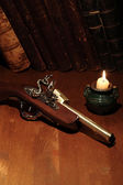 Old Pistol And Books — Stock Photo