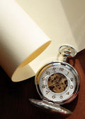 Pocket Watch On The Scroll — Стоковое фото
