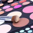 Professional make-up brush on eyeshadows palette — Stock Photo