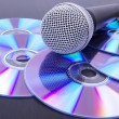 Microphone on compact discs — Stock Photo #5884053