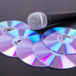 Vocal microphone and cd discs on table — Stock Photo #5884056